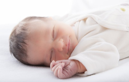 baby facial expressions: Close-up of a baby boy sleeping Stock Photo