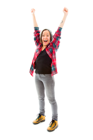Young woman celebrating with her arms raised Stock Photo