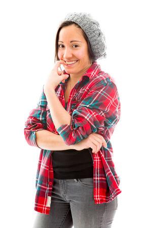 Young woman biting nail photo