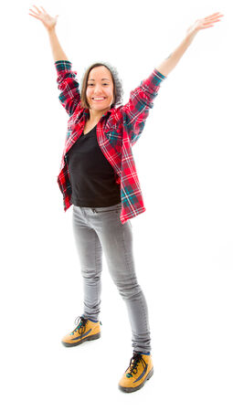 Young woman celebrating with her arms raised Reklamní fotografie