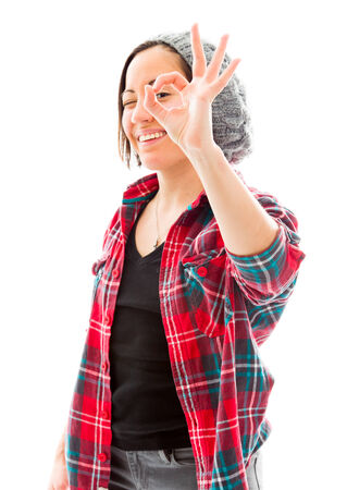 fully unbuttoned: Young woman looking through fingers, making ok sign