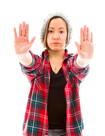 Young woman making stop gesture sign photo