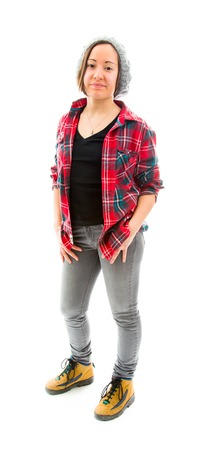 fully unbuttoned: Young woman standing with her hands in pockets Stock Photo