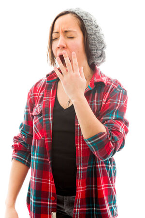 fully unbuttoned: Young woman yawning Stock Photo