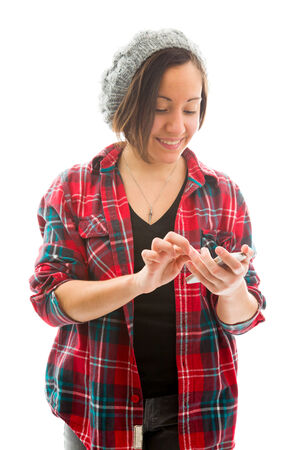 fully unbuttoned: Young woman text messaging on mobile phone