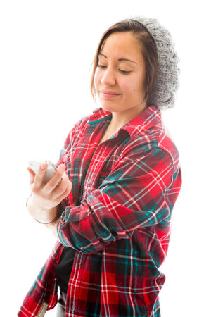 Young woman reading text message on phone Stock Photo