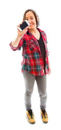 fully unbuttoned: Young woman showing a smart phone Stock Photo