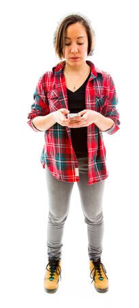 Young woman text messaging on mobile phone photo
