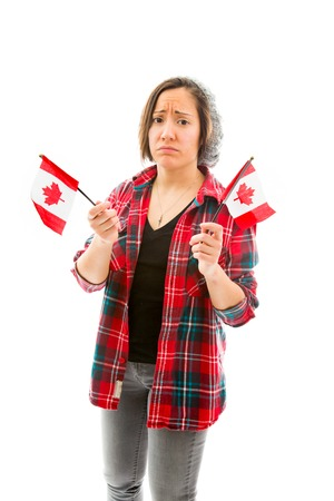 Young woman looking sad and holding Canada flag Stock Photo