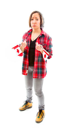 fully unbuttoned: Worried young woman holding Canadian Flag Stock Photo