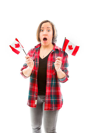 Young woman looking shocked with holding Canada flag