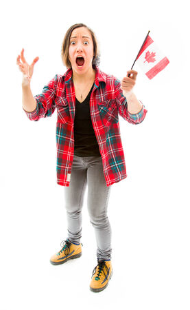 fully unbuttoned: Young woman looking shocked with holding Canada flag