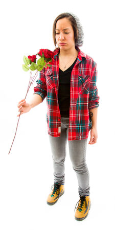 fully unbuttoned: Young woman looking worried with holding rose