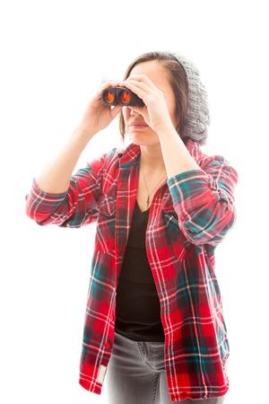 Young woman looking through binoculars photo