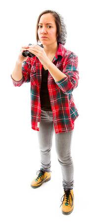 Young woman holding binoculars photo