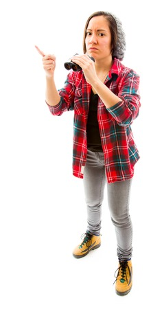 Young woman showing something holding binoculars photo
