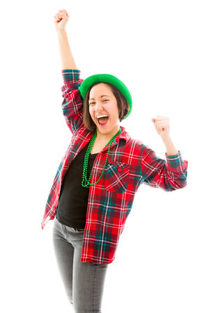 Young woman celebrating with her arms raised Banco de Imagens