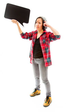 Confused woman with holding a blank speech bubble