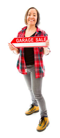 Saleswoman holding a Garage sale sign photo