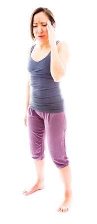 aching: Young woman suffering from headache Stock Photo