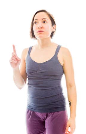 Jeune femme pointant son doigt vers le haut Banque d'images - 29396561