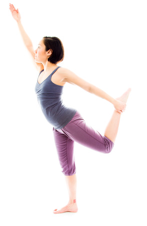 Young woman practicing yoga photo