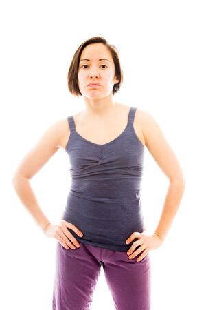 arms akimbo: Young woman standing with her arms akimbo