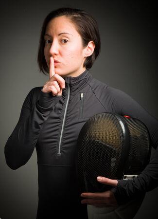 esgrimista: Esgrimista Mujer con un dedo en los labios Foto de archivo