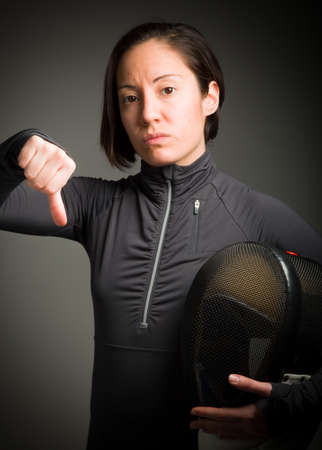 Female fencer showing thumbs down sign photo