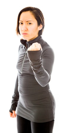 Young angry woman with fist up isolated on white background photo