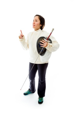 Female fencer holding a mask and sword with pointing up photo