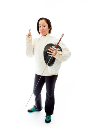 crossing fingers: Female fencer wishing with crossing fingers with a holding a mask and sword