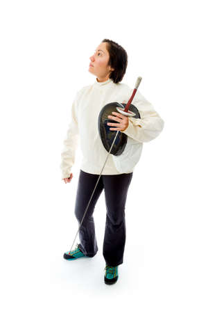 Female fencer thinking with holding a mask and sword Stock Photo