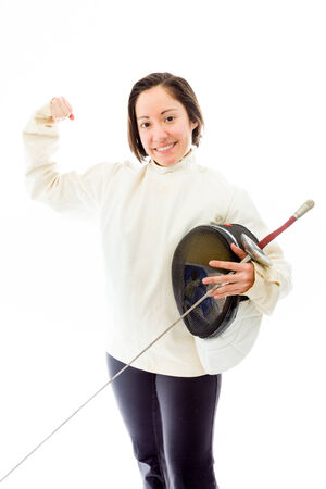 Female fencer smiling with flexing biceps