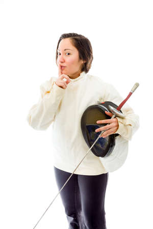 Female fencer with finger on lips Stock Photo
