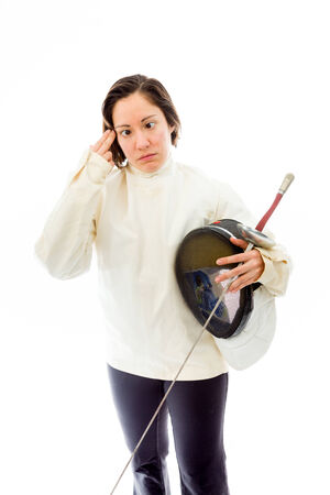 Young woman holding her finger against her head Stock Photo