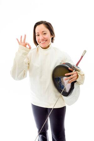 quarter foil: Female fencer showing ok sign