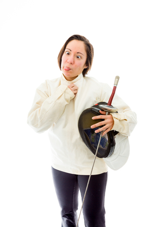 Female fencer sticking her tongue out