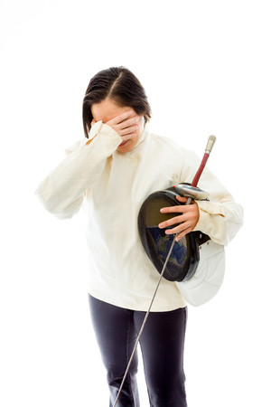 quarter foil: Female fencer looking frustrated Stock Photo