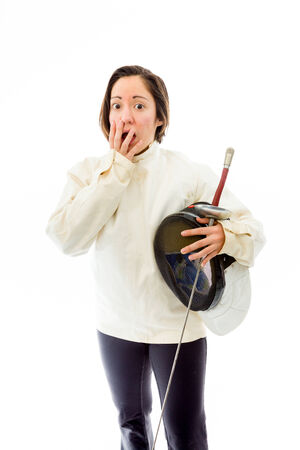 Female fencer hand over her mouth and shock Banque d'images