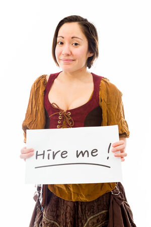 Young woman showing hire me sign on white background photo