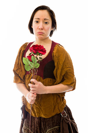 Young woman looking sad with holding red rose