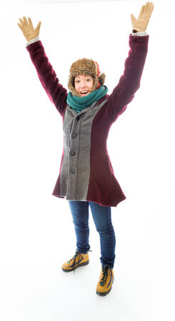 Young woman in warm clothing celebrating success