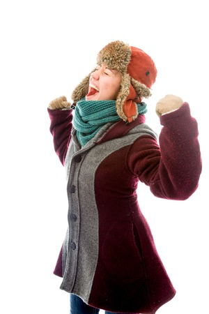 Young woman in warm clothing and celebrating success Stok Fotoğraf