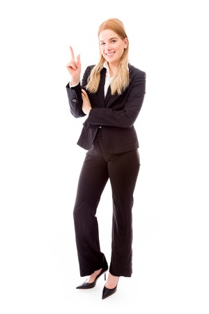 Businesswoman pointing finger up photo