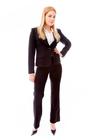 Businesswoman standing with hand on hip photo
