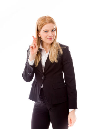 fingers: Businesswoman crossing fingers Stock Photo