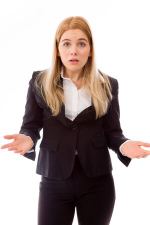 Shocked businesswoman shrugging with raised hands photo