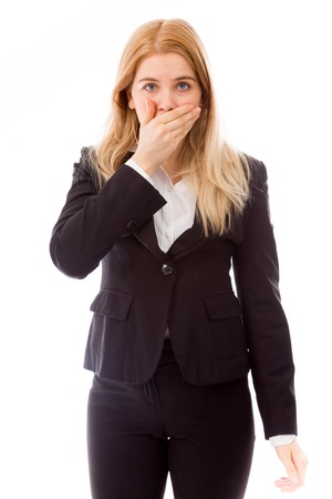 Businesswoman with hand over her mouth