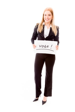 vote: Businesswoman holding a vote placard Stock Photo